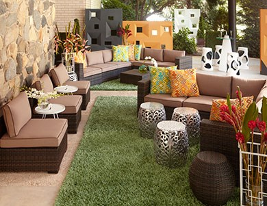 Even a small terrace or patio can be transformed with outdoor furnishings, printed pillows and potted plants.