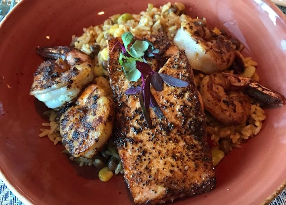 Pan-roasted salmon with peas, succotash and pecan brown butter is a favorite at Prime Meridian.