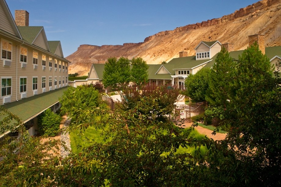 The Wine Country Inn is surrounded by 21 acres of grape vines and is adjacent to two wineries.