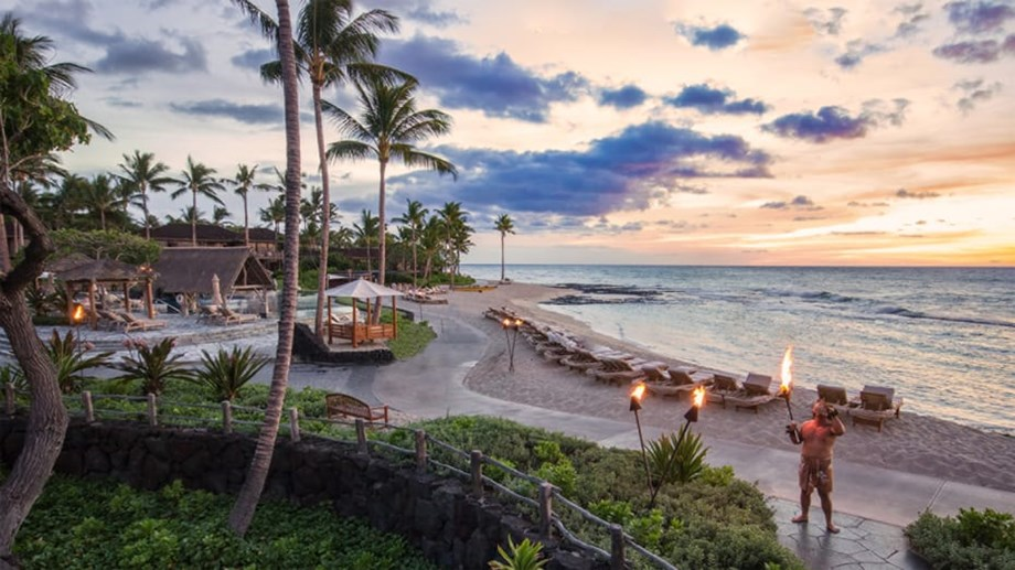 At the Four Seasons Resort Hualalai on Hawaii's Big Island, it's tradition to blow the conch shell at sunset.